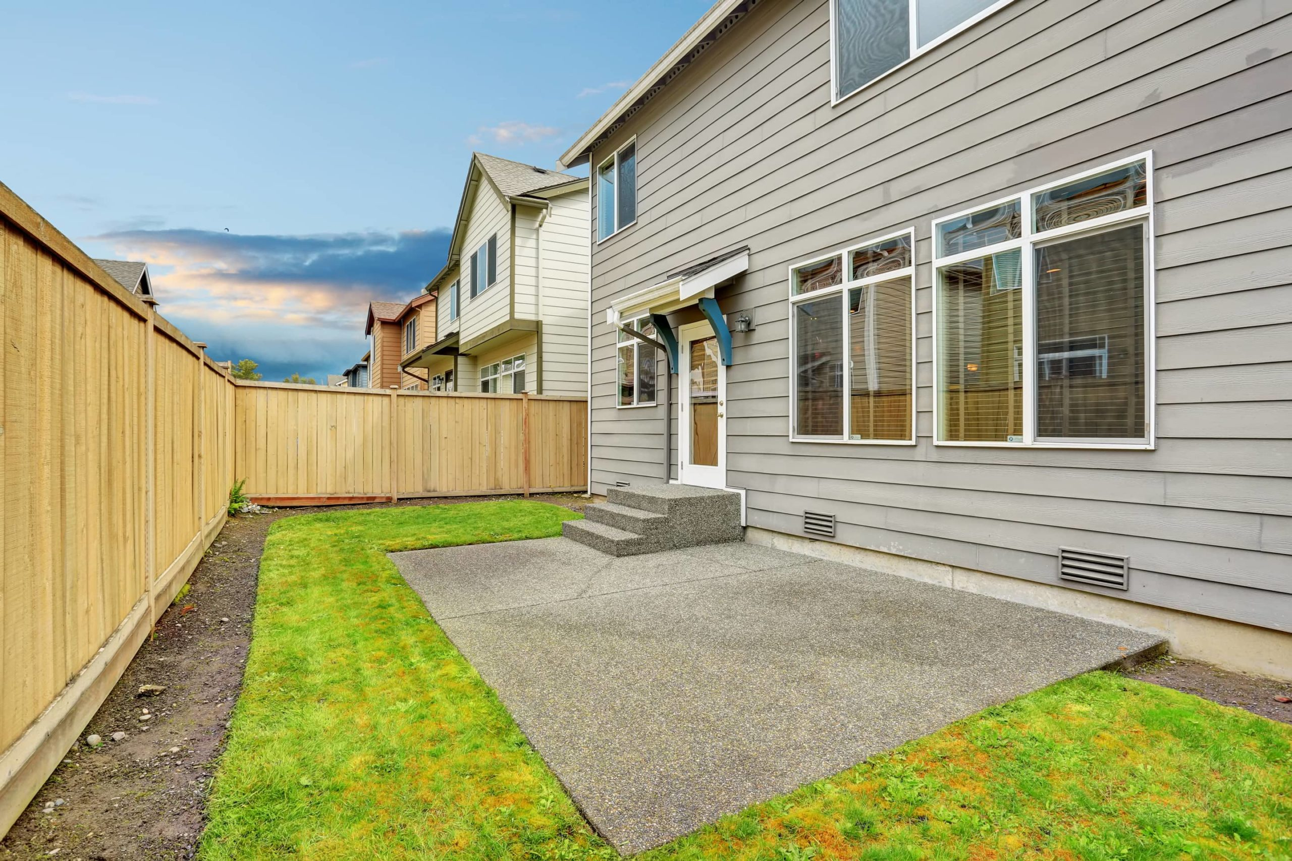 This is an image of a simple rectangular backyard concrete patio.