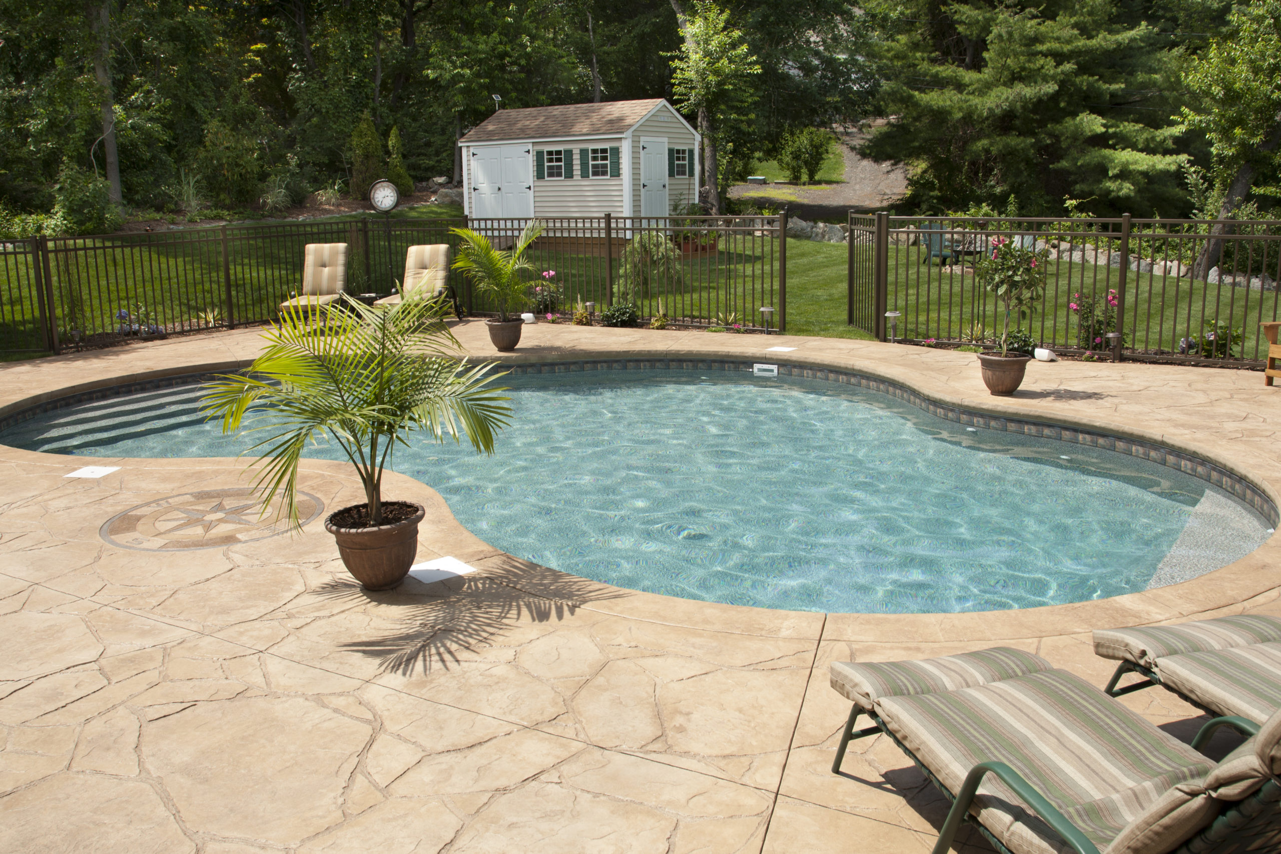 This is an image of a stamped concrete pool deck on a residential property.