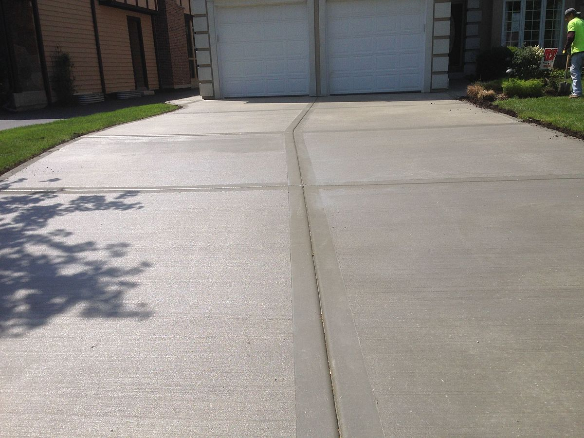 This is an image of a residential concrete driveway.